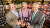 Toasting the success of Okanagan Spring and Sleeman's planned brewery expansion are (left to right) Eric Foster, MLA for Vernon-Monashee; Stefan Tobler, Okanagan Spring brewmaster; and Dave Klaassen, Sleeman vice-president of Operations.
