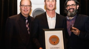 Dr. Don Livermore of Corby Distillers (centre) accepts the award for Canadian Whisky of the Year from Davin de Kergommeaux (left) and renowned whisky author Dave Broom (right). (PRNewsFoto/Canadian Whisky Awards)
