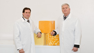 Paul Vickers (left), Chair of the Board, Gay Lea Foods Co-operative Limited and Garnet Schellen, president, (right), Amalgamated Dairies Limited
