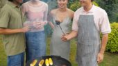 Front view of four young people having a barbecue