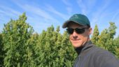 Katan Kitchens president and CEO Jamie Draves stands in a quinoa field (Photo source: Jamie Draves, Katan Kitchens)