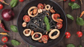 Italian black spaghetti pasta with mussels and squid rings
