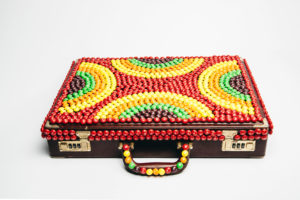 Norm Kelly's briefcase, adorned with Skittles
