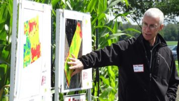 Steve Redmond shows a field map and explains what the GPS technology is able to identify. (Photo source: Hensall District Co-op, AgInnovation Ontario)