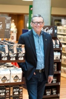 John E. Betts, president and CEO of McDonald's Canada, with the chain's new McCafé coffee lineup for grocery