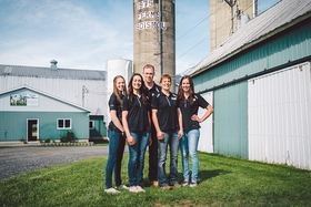 Mario Lefebvre and Denise Joyal and their three daughters.  Photo from Dairy Farmers of Canada website.
