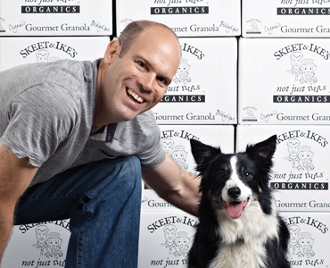 Ian Walker, president of Left Coast Naturals, with Chili
