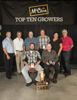 Front Row, L-R: André Levesque, Jean-Guy Levesque. Back Row, L-R: Luc Coté, Field Department Manager, Allison McCain, Chairman, McCain Foods Limited, Luc Levesque, Jules Levesque, Christine Wentworth, VP Agriculture NA, Dale McCarthy, VP Integrated Supply Chain NA.